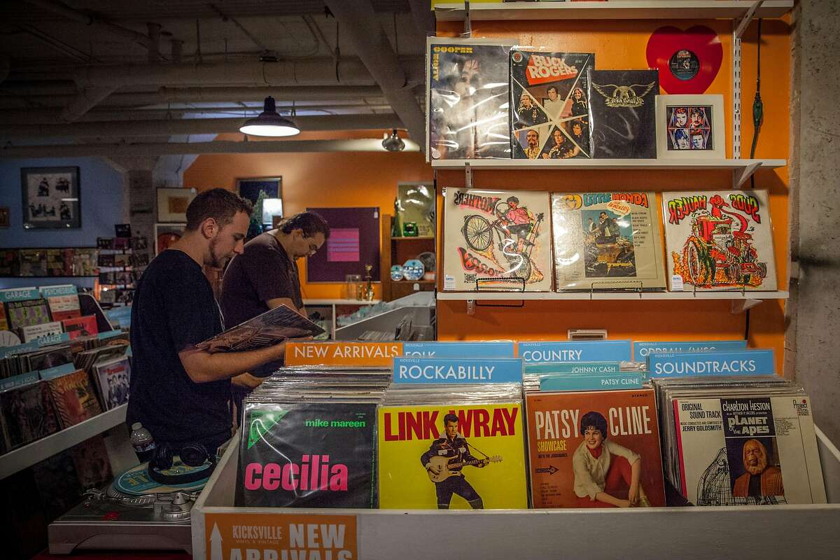 Vinyl seekers Medium Rage -Records & Collectibles who share common space with Kicksville Vinyl & Vintage at the WAL Public Market - in Sacramento, California, USA 16 Aug 2017. Medium Rage -Records & Collectibles and Kicksville Vinyl & Vintage store is split up the center and identified by different wall colors, Blue and Orange. (Peter DaSilva/Special to The Chronicle)