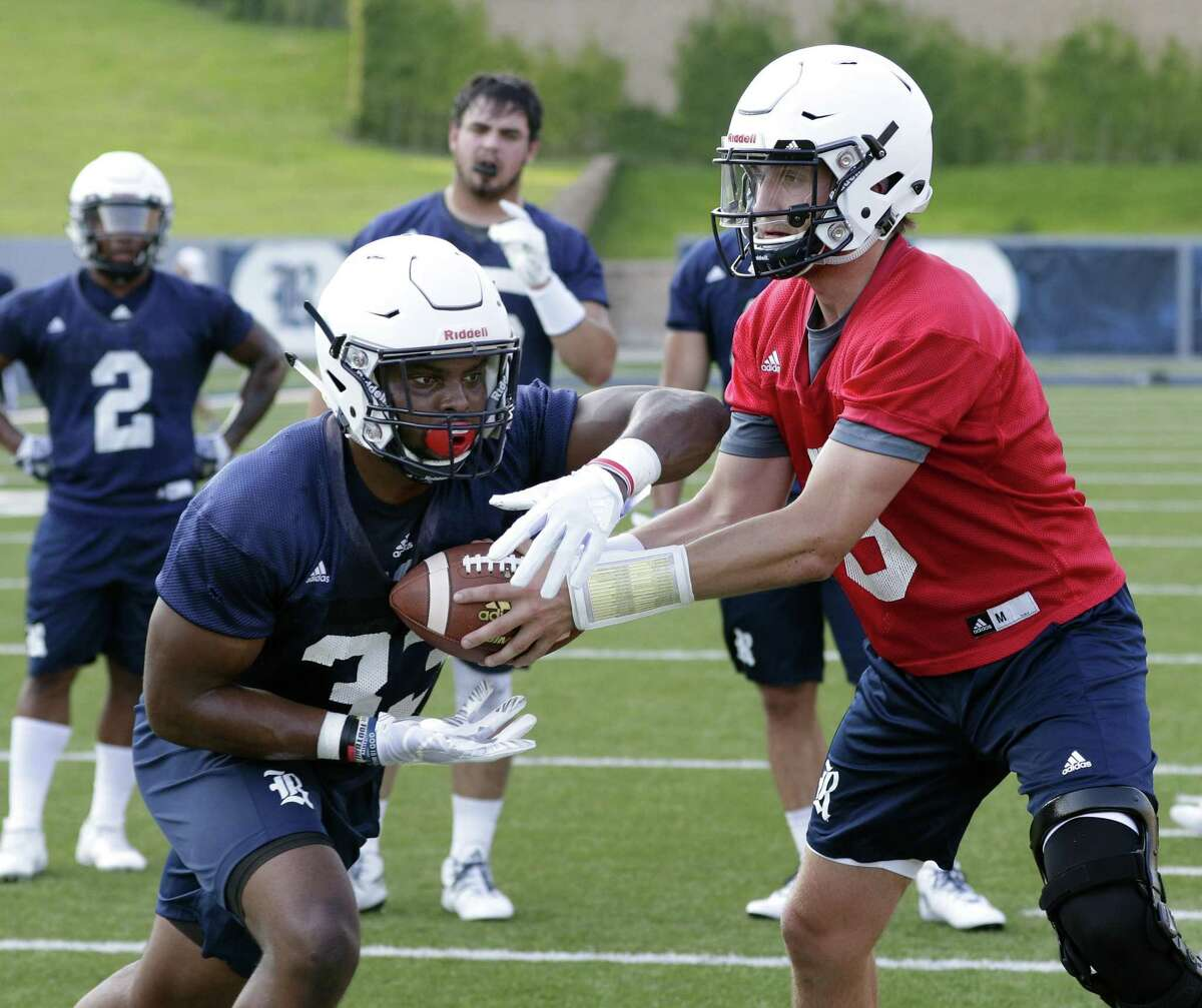 Rice quarterback Shawn Stankavage hands off to Emmanuel Esukpa during a football practice at Rice Stadium Friday July 27, 2018 in Houston, TX. Michael Wyke/Contributor