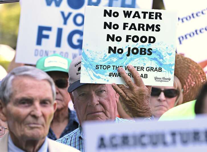 California farmers rally at the Capitol to protest a proposal by state water officials to increase water flows for the lower San Joaquin River to protect fish, at the Capitol, Monday, Aug. 20, 2018, in Sacramento, Calif. The State Water Resources Control Board is holding hearings this week concerning a plan to allow more water to flow freely down the Sacramento-San Joaquin River Delta from February to June, meaning less water will be available for farming and other needs. (AP Photo/Rich Pedroncelli)