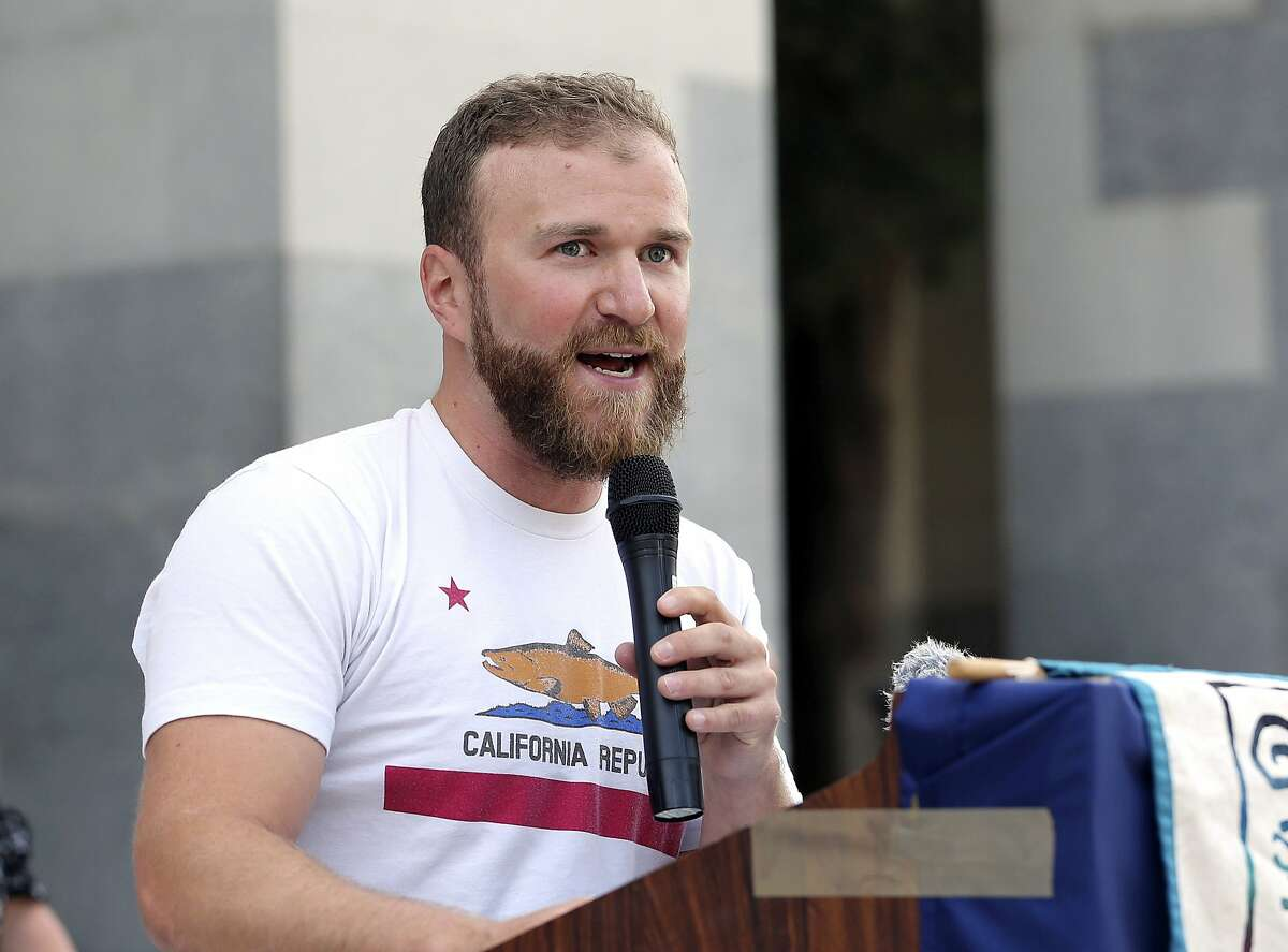 Noah Oppenheim, of the Pacific Coast Federation of Fishermen's Associations, speaks in support of a proposal by state water officials to increase water flows for the lower San Joaquin River to protect fish, at the Capitol, Monday, Aug. 20, 2018, in Sacramento, Calif. The State Water Resources Control Board is holding hearings this week concerning a plan to allow more water to flow freely down the Sacramento-San Joaquin River Delta from February to June, meaning less water will be available for farming and other needs. (AP Photo/Rich Pedroncelli)