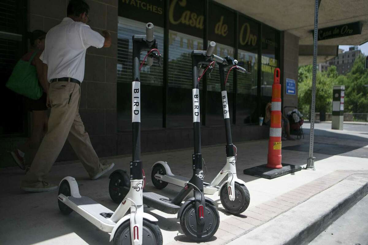 Electric Bird scooters sit along Soledad Street in downtown San Antonio July 1, 2018. There are around 150 Bird electric scooters deployed downtown, in Dignowitty Hill, Government Hill and Southtown. Anyone can use them by downloading the Bird app and paying $1 plus $0.15 per minute. The city didn't know about the recent deployment of the devices, which can be left anywhere, but is working quickly to develop regulations.