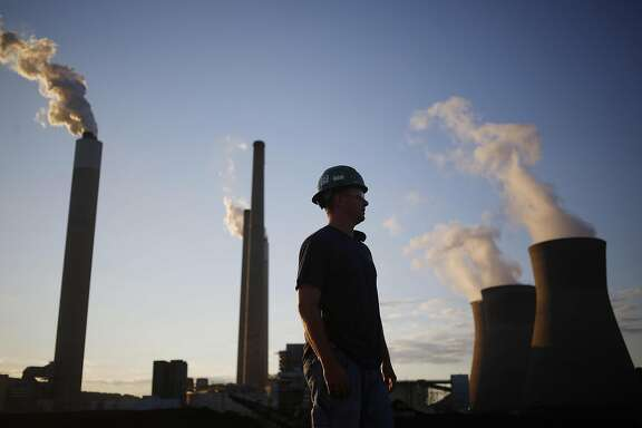 A worker stands in the coal yard at the American Electric Power Co. (AEP) coal-fired John E. Amos Power Plant in Winfield, West Virginia, U.S., on Wednesday, July 18, 2018. American Electric Power Co., Duke Energy Corp., and others say they can't recoup money they spent to meet requirements to cut mercury and other air toxics from their facilities and therefore want the Environmental Protection Agency (EPA) to retain the Mercury and Air Toxics Standards (MATS) rule as is. Photographer: Luke Sharrett/Bloomberg