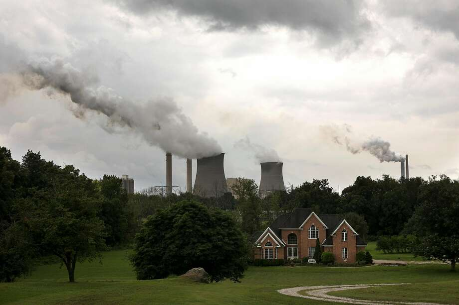 Steam billows from the coal-fired Gavin Power Plant in Cheshire, Ohio, Aug. 21, 2018. The Trump administration unveiled its overhaul of pollution rules for coal-fired power plants, and its analysis shows an increase of up to 1,400 premature deaths annually. (Maddie McGarvey/The New York Times) Photo: Maddie Mcgarvey, NYT