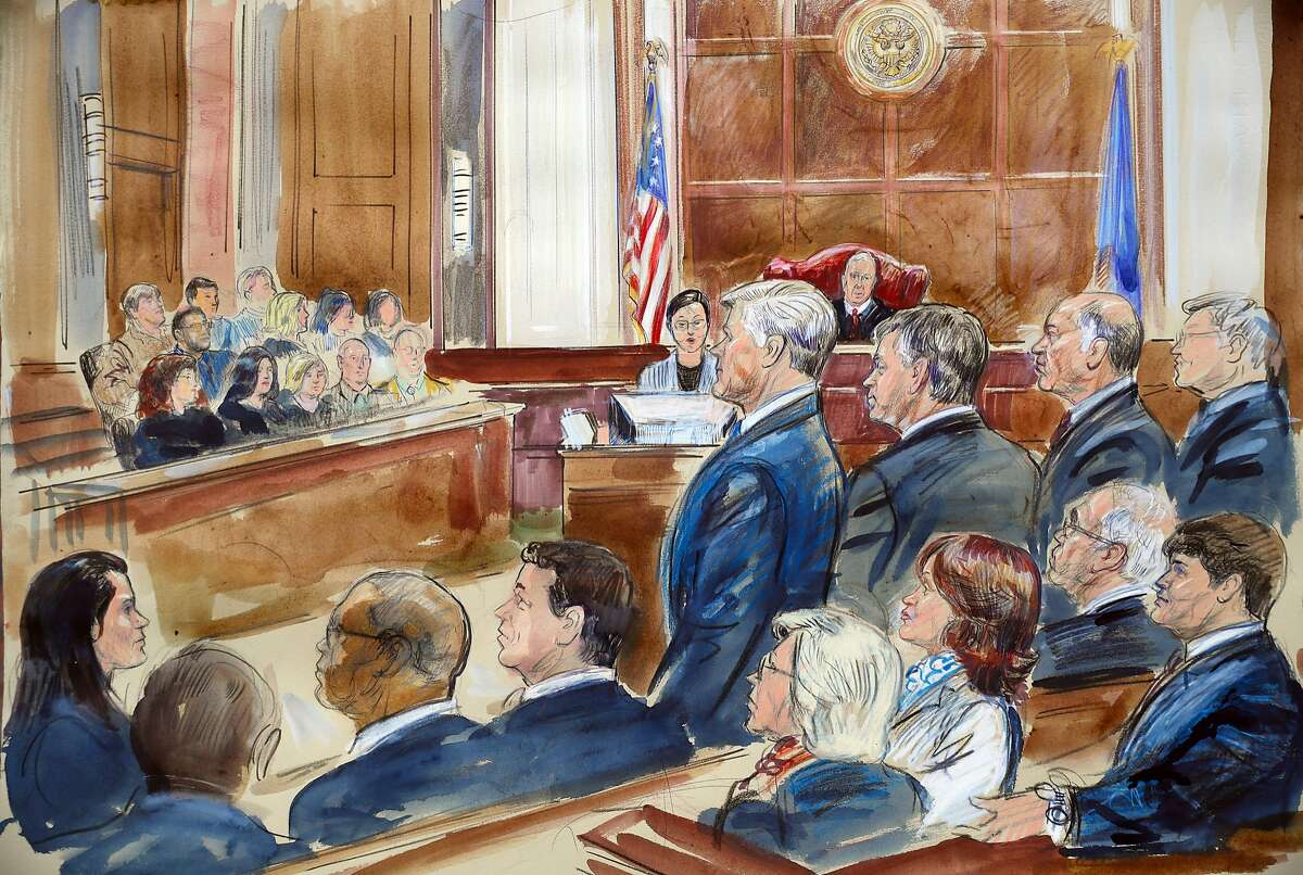 This courtroom sketch shows Paul Manafort, third from the right, and members of his defense team including Kevin Downing, standing left, as they listen to verdicts in federal court in Manafort's the bank fraud and tax evasion trial in the courtroom of U.S. District court Judge T.S. Ellis III in Alexandria, Va., Tuesday, Aug. 21, 2018. (Dana Verkouteren via AP)