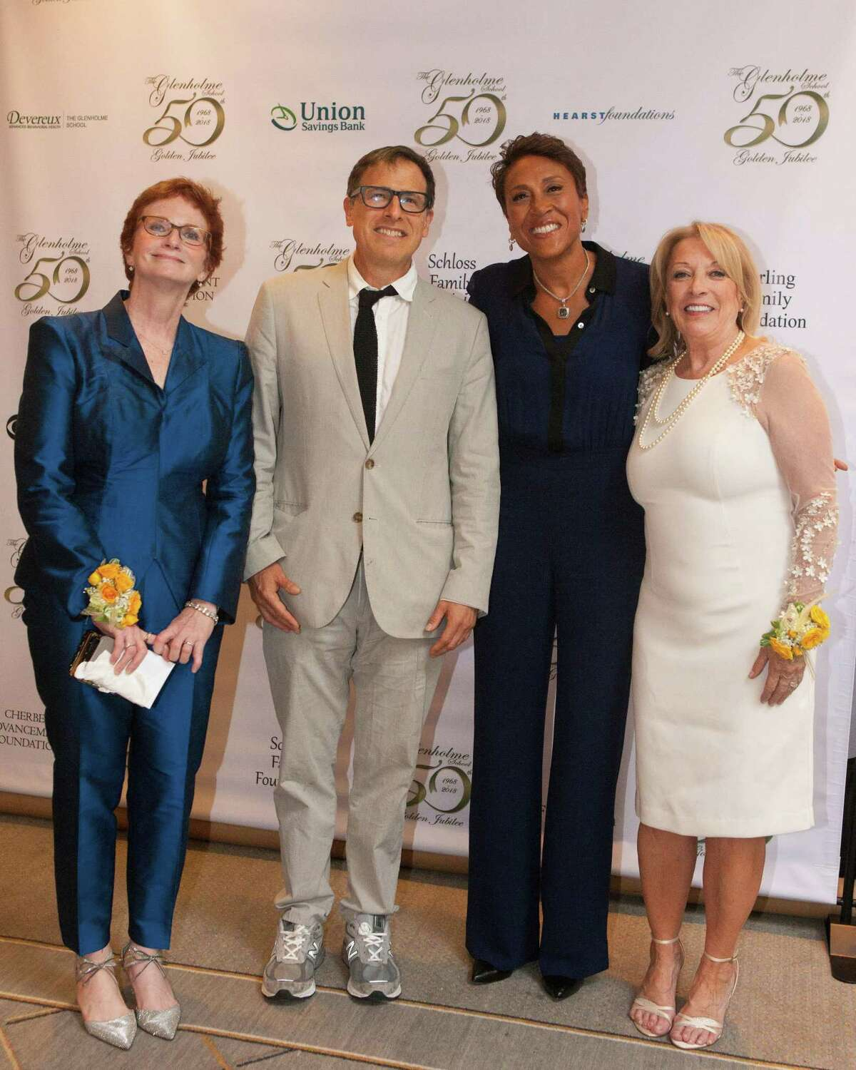 The Glenholme School in Washington recently hosted its 50th Jubilee Gala at Ethan Allen Hotel in Danbury. In attendance were, from left to right, Barbara Feeney, Glenholme Board Chairman, film director David O. Russell, guest emcee Robin Roberts of ABCs Good Morning America, and Glenholme Executive Director Maryann Campbell.