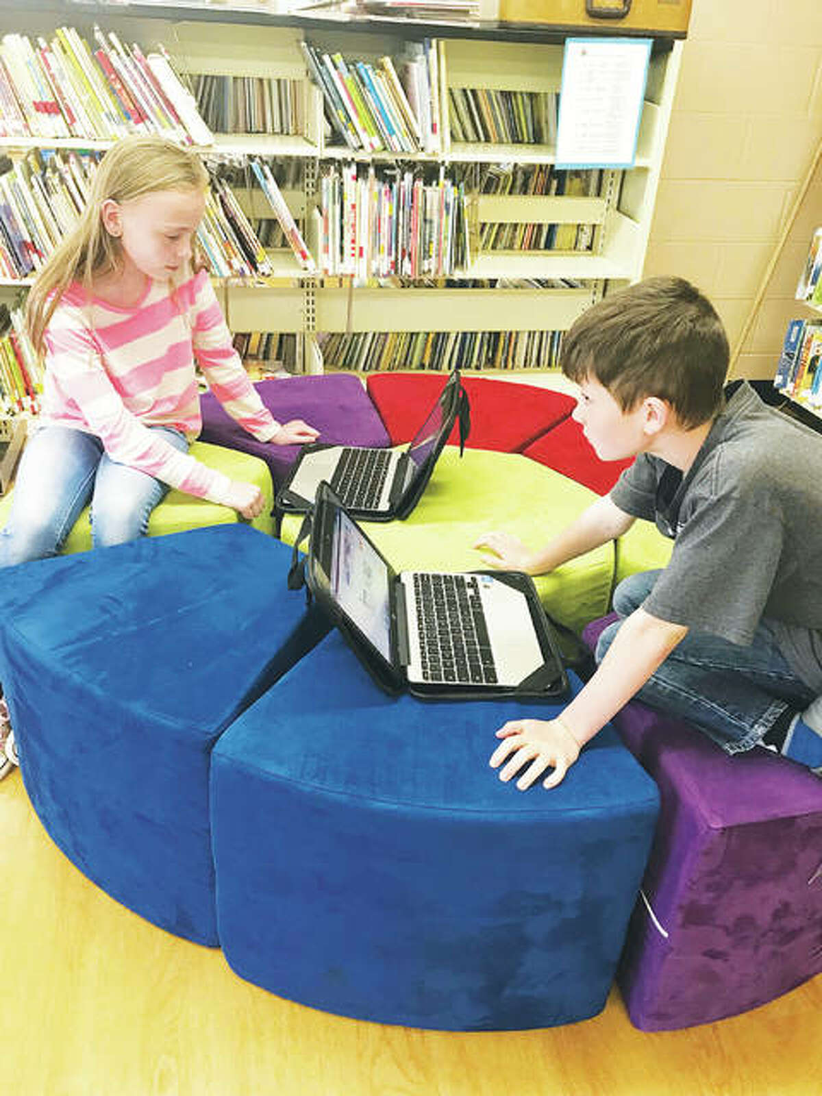 Fourth-grade students Claire Settles and Tucker Durbin work together on their Chromebooks, seated comfortably, which was a major priority when it came to students' wants for the new library media center. Teachers visited classrooms and placed suggestion boxes for youngsters' ideas, all of which were read, Mount Olive reading teacher Mary Griffel said.
