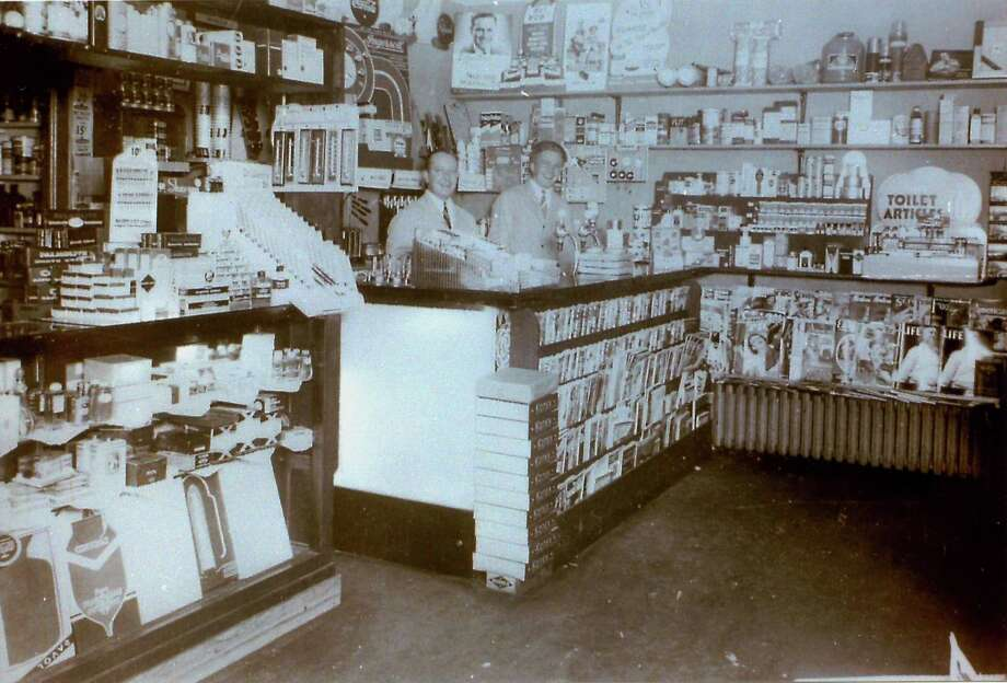 Gunn Historical Museum's Washington History Club in the Morning will next meet Sept. 17 at 10 a.m. at the Washington Senior Center in Bryan Hall Plaza. The topic of discussion will be the history of Washington's pharmacies, including Church, Ford, and Co. Druggists, Waramaug Patent Medicine and Luncheonette, Green Drug, Parks Drug, Robert J. Benham's, The Rexall Drug Store, Washington Pharmacy, New Preston Pharmacy and others. All past owners, pharmacists, family members, employees, and customers are invited to attend to share history, conversations, photographs and more. Above, Harold Dutch Stoeffler and Walter Quist are shown behind the counter in the Washington Pharmacy on Main Street in Washington Depot in 1938. If you have a Way Back When photo to share, contact Deborah Rose at drose@newstimes.com or 860-355-7324. Photo: Courtesy Of Harold Honey Stoeffler / The News-Times Contributed