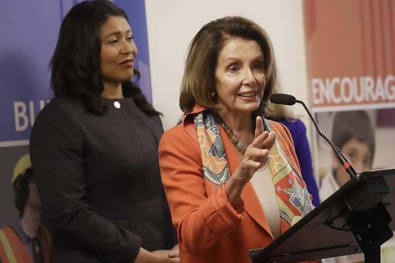 House Minority Leader Nancy Pelosi, right, speaks next to San Francisco Mayor London Breed, left, during a news conference at the Tenderloin Neighborhood Development Corporation's Sala Burton Manor in San Francisco, Tuesday, Aug. 21, 2018. (AP Photo/Jeff Chiu)