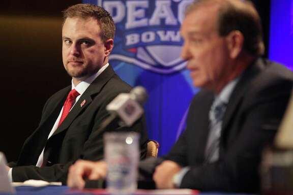 Houston Cougars head coach Tom Herman listens to Florida State University head coach Jimbo Fisher  during a joint press conference for the Chick-fil-A Peach Bowl on Wednesday, Dec. 30, 2015, in Atlanta. ( Elizabeth Conley / Houston Chronicle )
