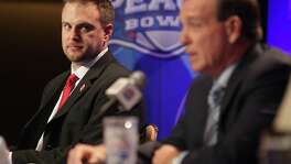Houston Cougars head coach Tom Herman listens to Florida State University head coach Jimbo Fisher during a joint press conference for the Chick-fil-A Peach Bowl on Wednesday, Dec. 30, 2015, in Atlanta.