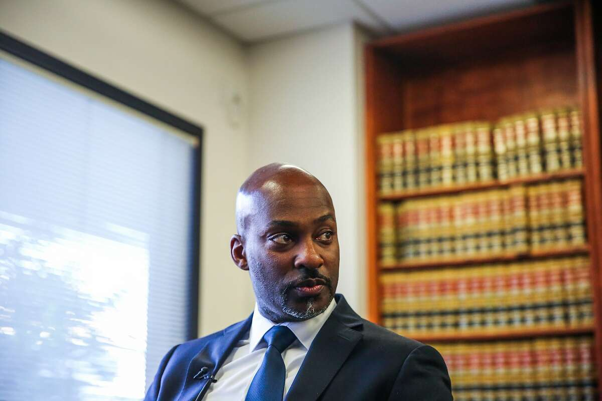Alameda County Public Defender Brendon Woods listens while he is questioned by the press regarding issues with the Odyssey software system, at the Alameda County Grand Jury, in Oakland, California, on Tuesday, Nov. 29, 2016.