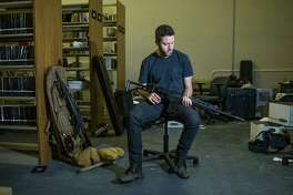 Cody Wilson, director of Defense Distributed, sits in his library behind the company's factory in Austin, Texas, on Aug. 5.