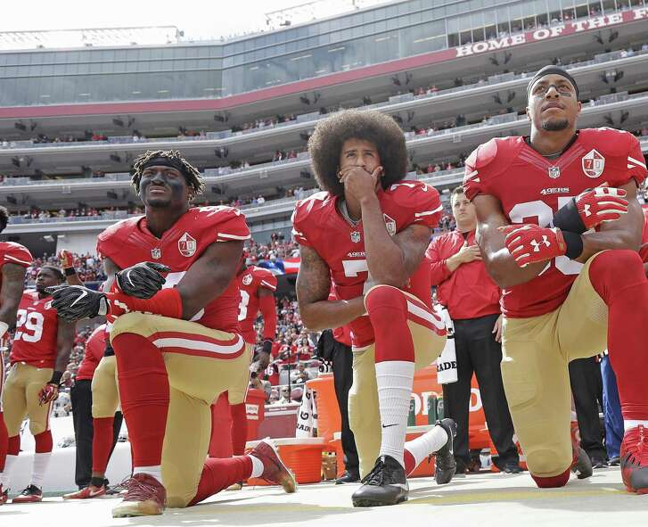 FILE - In this Oct. 2, 2016 file photo, from left, San Francisco 49ers outside linebacker Eli Harold, quarterback Colin Kaepernick and safety Eric Reid kneel in protest during the national anthem before an NFL football game against the Dallas Cowboys in Santa Clara, Calif. (AP Photo/Marcio Jose Sanchez, File)