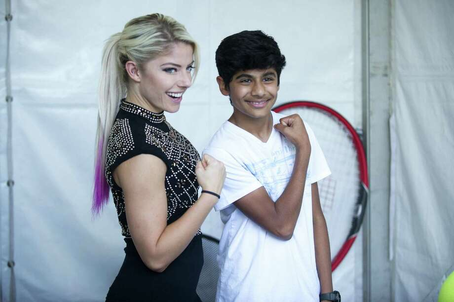 WWE superstar Alexa Bliss poses with 13-year-old Krish Bhuva, of Shrewsbury, Mass., at the Connecticut Open in New Haven on Tuesday. Photo: Michael Cummo / Hearst Connecticut Media / Stamford Advocate