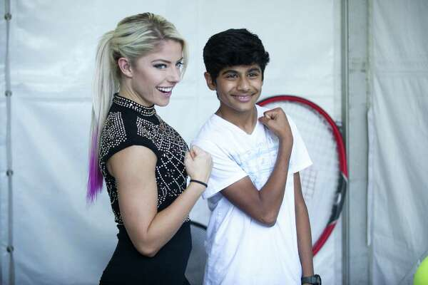 WWE superstar Alexa Bliss poses with 13-year-old Krish Bhuva, of Shrewsbury, Mass., at the Connecticut Open in New Haven on Tuesday.