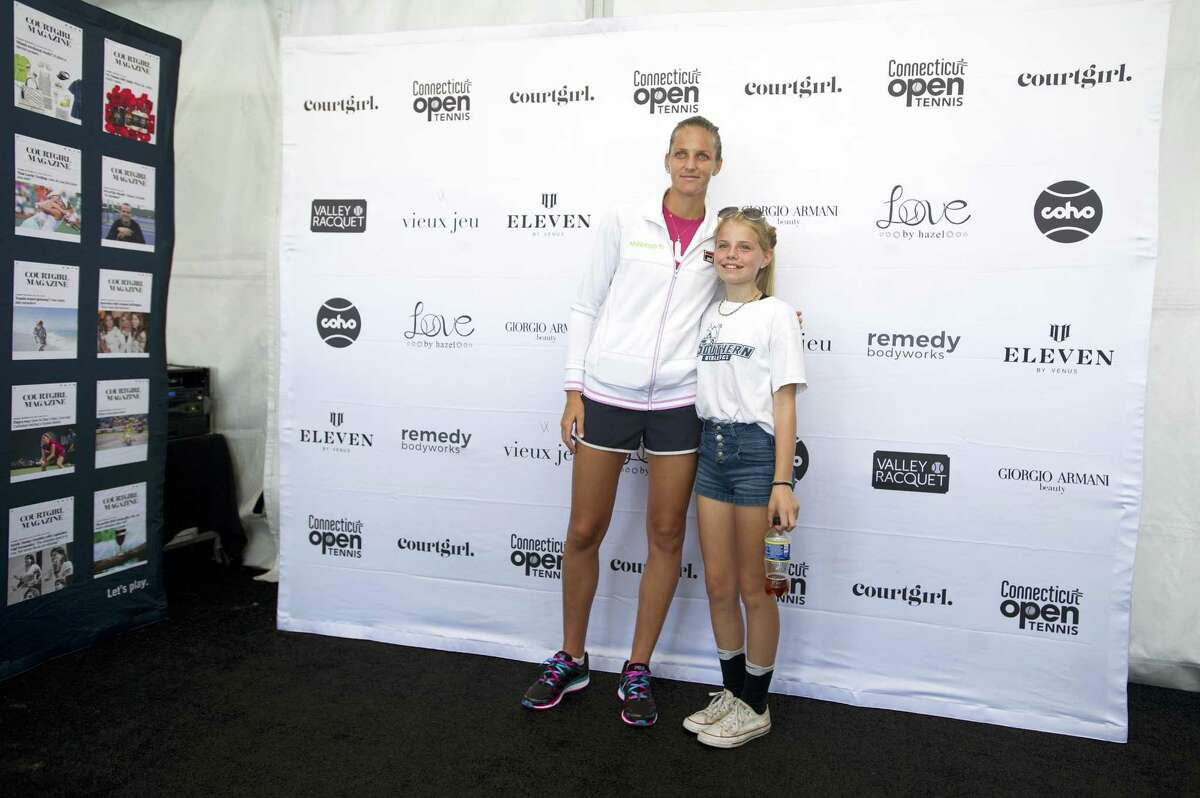 Karolina Pliskova poses for a photo with Loretta Szych, of Stafford, Conn., during the 2018 Connecticut Open in New Haven, Conn. on Tuesday, Aug. 21, 2018.