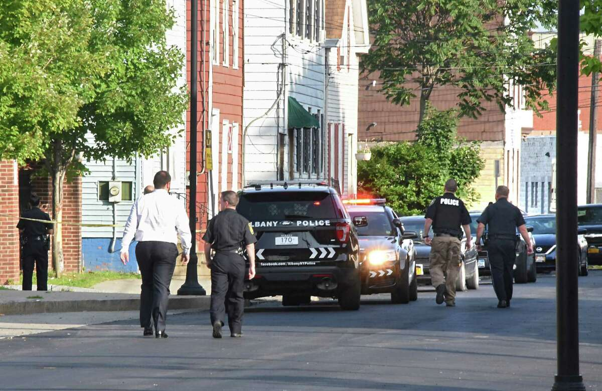Police investigate the scene of a police involved shooting on the 300 block of Elk St. on Monday, Aug. 20, 2018 in Albany, N.Y. (Lori Van Buren/Times Union)