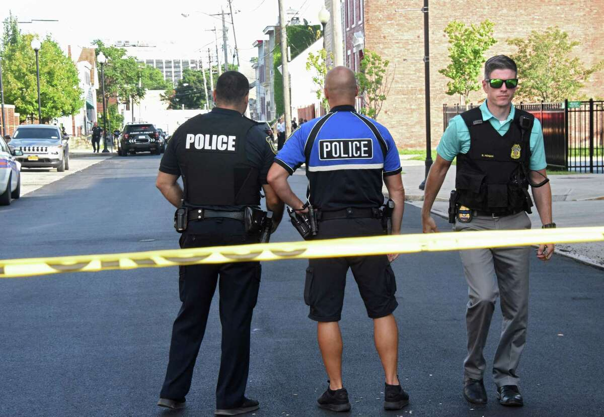 Police investigate the scene of a shooting on the 300 block of Elk Street on Monday, Aug. 20, 2018 in Albany, N.Y. (Lori Van Buren/Times Union)