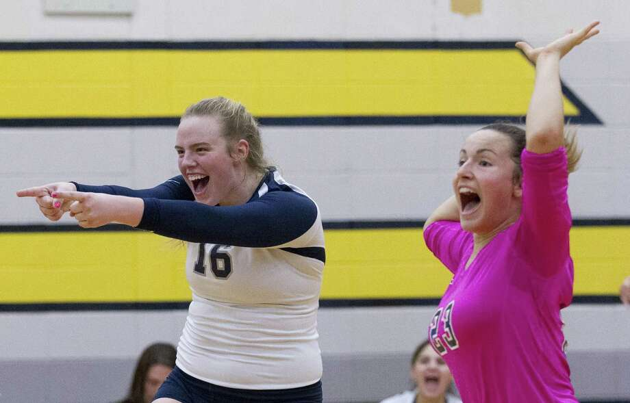 College Park's Annie Cooke (16) reacts beside Jill Bohnet (23) after a block during the first set of a District 15-6A high school volleyball match at Conroe High School on Tuesday, Aug. 21, 2018, in Conroe. Photo: Jason Fochtman, Houston Chronicle / Staff Photographer / © 2018 Houston Chronicle