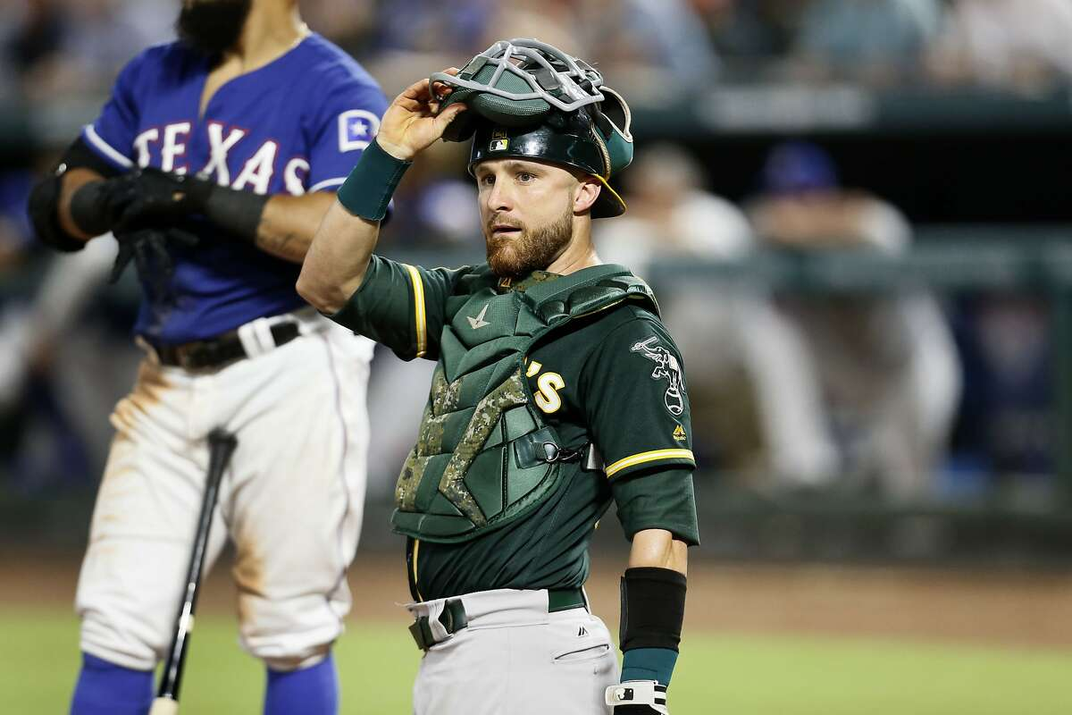 Oakland Athletics catcher Jonathan Lucroy looks to the dugout during a baseball game against the Texas Rangers, Tuesday July 24, 2018, in Arlington, Texas. (AP Photo/Roger Steinman)