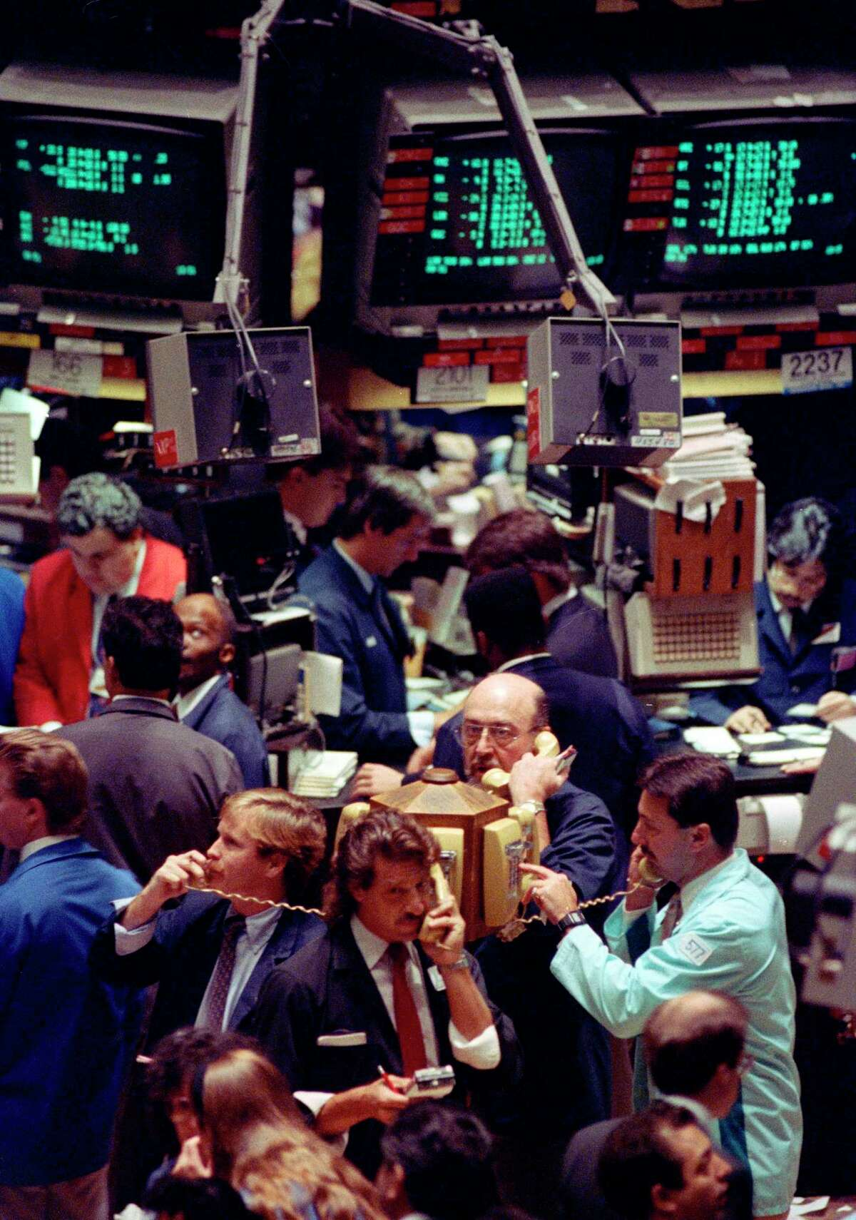 FILE- In this Oct. 5, 1990, file photo traders on the New York Stock Exchange. In 1990, the S&P 500 declined 19.92 percent from July 16 until Oct. 11. (AP Photo/Richard Drew)