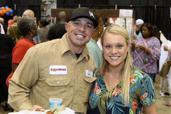 Lee Sullivan and Kayla Kedel during the Tasting for Some Other Place at the Beaumont Civic Center. The event is a fundraiser for the organization the helps feed the hungry. Photo taken Tuesday 8/21/18 Ryan Pelham/The Enterprise