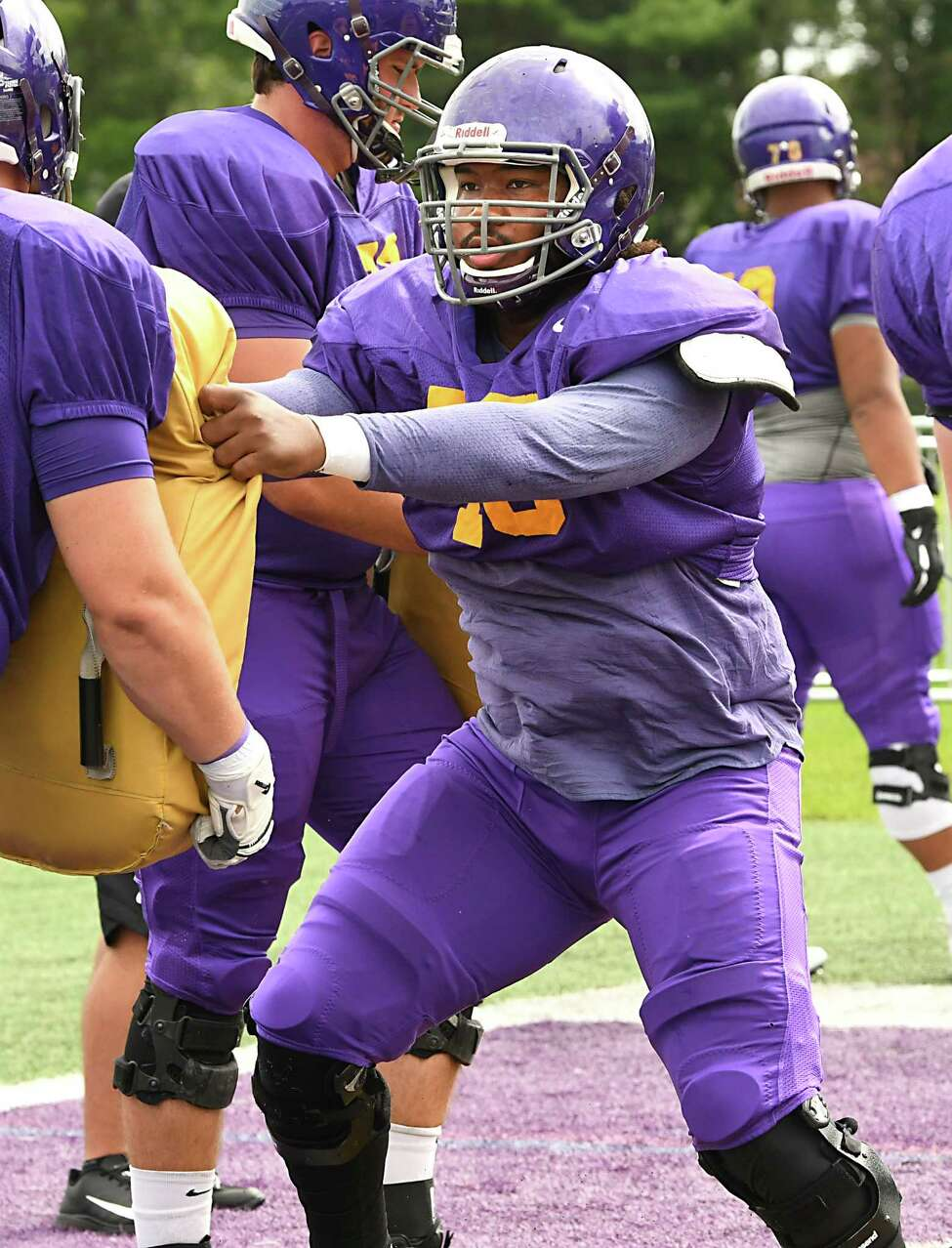 UAlbany offensive lineman Micah Royster runs drills during football practice at Casey Stadium on Tuesday, Aug. 21, 2018 in Albany, N.Y. (Lori Van Buren/Times Union)