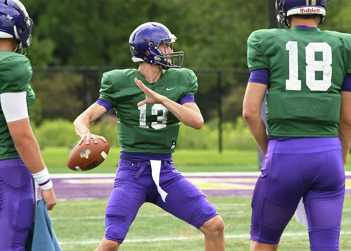 UAlbany quarterback Nyc Burns throws the ball during football practice at Casey Stadium on Tuesday, Aug. 21, 2018 in Albany, N.Y. (Lori Van Buren/Times Union)