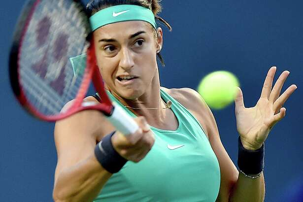 France's Caroline Garcia lines up a returns to Belarusian Aliaksandra Sasnovich on the Stadium Court August 21, 2018, at the Connecticut Open at the Connecticut Tennis Center at Yale in New Haven.