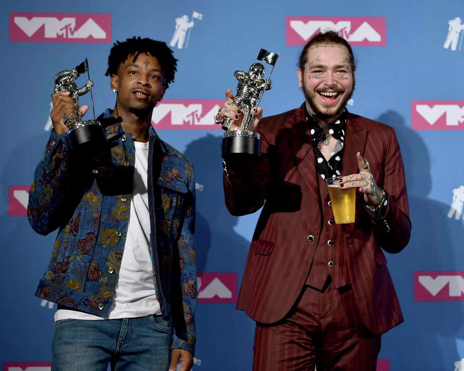"21 Savage, left, and Post Malone pose with their award for song of the year for ""Rockstar"" in the press room at the MTV Video Music Awards at Radio City Music Hall on Monday, Aug. 20, 2018, in New York. (Photo by Evan Agostini/Invision/AP) Photo: Evan Agostini / Invision"