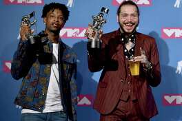 """21 Savage, left, and Post Malone pose with their award for song of the year for """"Rockstar"""" in the press room at the MTV Video Music Awards at Radio City Music Hall on Monday, Aug. 20, 2018, in New York. (Photo by Evan Agostini/Invision/AP)"""