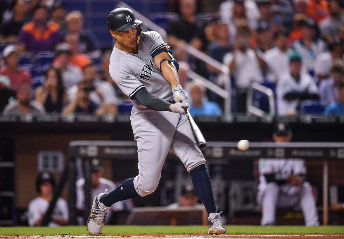 MIAMI, FL - AUGUST 21: Giancarlo Stanton #27 of the New York Yankees singles in the first inning against the Miami Marlins at Marlins Park on August 21, 2018 in Miami, Florida. (Photo by Mark Brown/Getty Images)