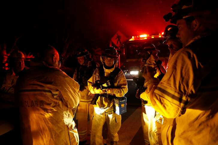 MIDDLETOWN, CA - SEPTEMBER 13: Fire captains with the Santa Clara County Fire Department gather for a briefing before their shift to battle the Valley Fire on September 13, 2015 in Middletown, California. The fast-moving fire has consumed 40,000 acres and is currently zero percent contained. (Photo by Stephen Lam/ Getty Images)