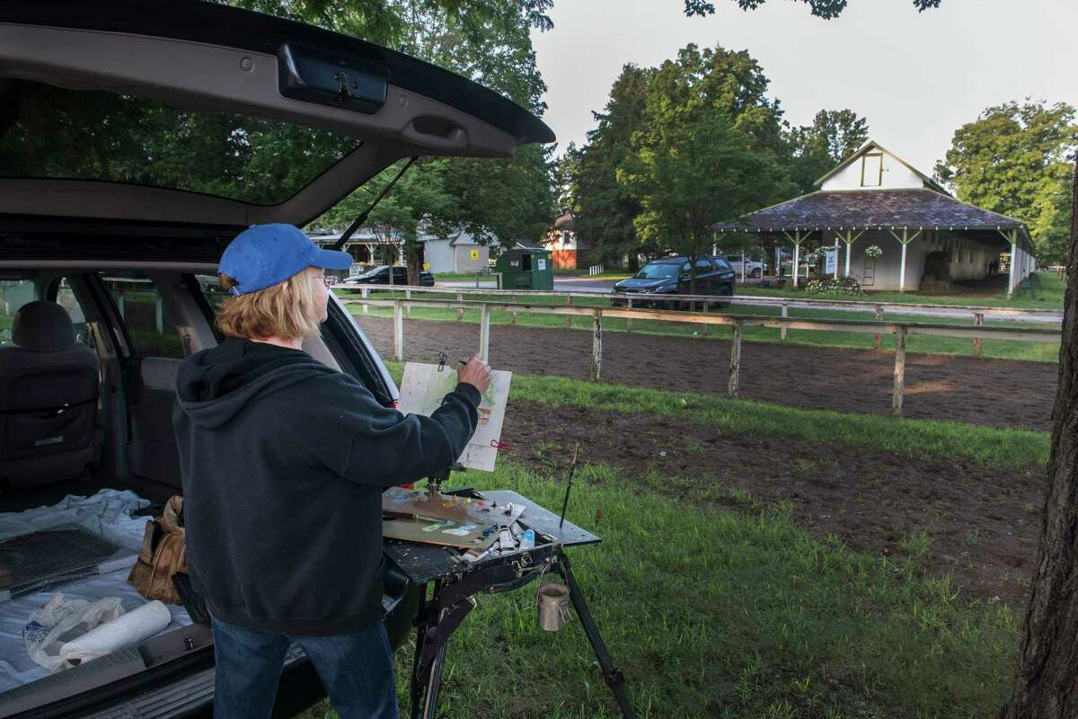 Artist Sharon Crute creates an impression of the barn area on Clare Court Monday Aug. 20, 2018 at the Saratoga Race Course in Saratoga Springs, N.Y. (Skip Dickstein/Times Union)