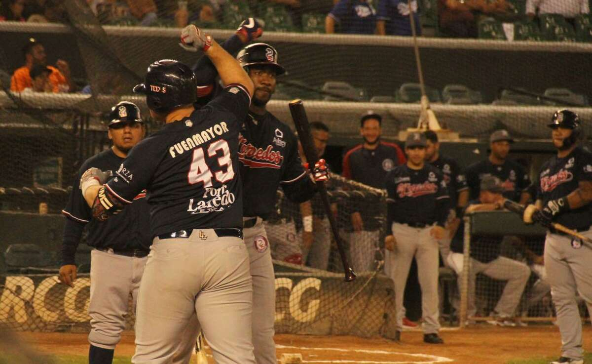 Tecolotes designated hitter Balbino Fuenmayor celebrates his eighth home run of the year with right fielder Domonic Brown.