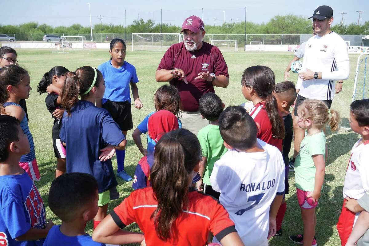 TAMIU Soccer Coach Claudio Arias talks to participants in the program's skills soccer camp, Tuesday, August 1, 2018, at TAMIU. The team will offer a 2-day, Wednesday and Thursday, free strikers camp for ages 6-12.