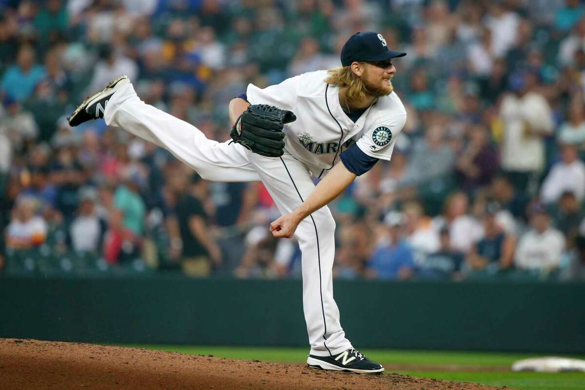 Seattle Mariners pitcher Ross Detwiler follows through on a pitch against the Houston Astros during the third inning of a baseball game Tuesday, Aug. 21, 2018, in Seattle. (AP Photo/Jennifer Buchanan)