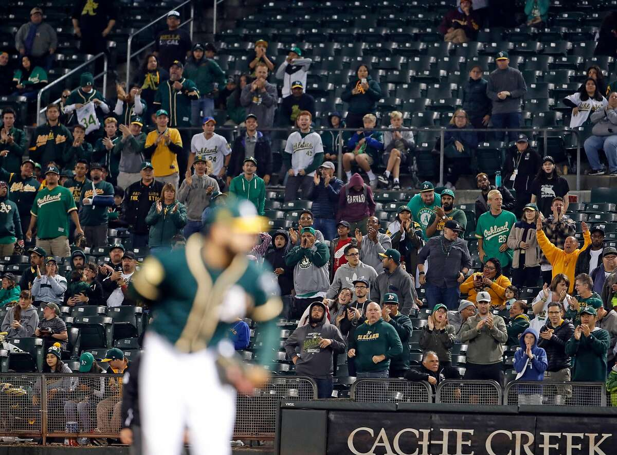 Oakland Athletics' fans cheer before final out of A's 6-0 win over Texas Rangers in MLB game at Oakland Coliseum in Oakland, Calif. on Tuesday, August 21, 2018.