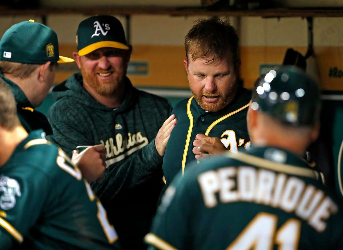 Oakland Athletics' starting pitcher Brett Anderson is congratulated after pitching 7 innings while giving up only 1 hit to Texas Rangers during MLB game at Oakland Coliseum in Oakland, Calif. on Tuesday, August 21, 2018.