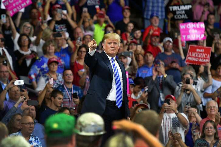 President Trump salutes his supporters at a political rally in Charleston, W.Va., hours after the guilty verdicts and pleas of two of his former top associates. Trump said little about Paul Manafort's legal troubles and nothing about Michael Cohen's.