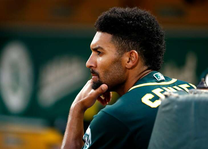 Oakland Athletics' Marcus Semien watches MLB game against Texas Rangers at Oakland Coliseum in Oakland, Calif. on Tuesday, August 21, 2018.