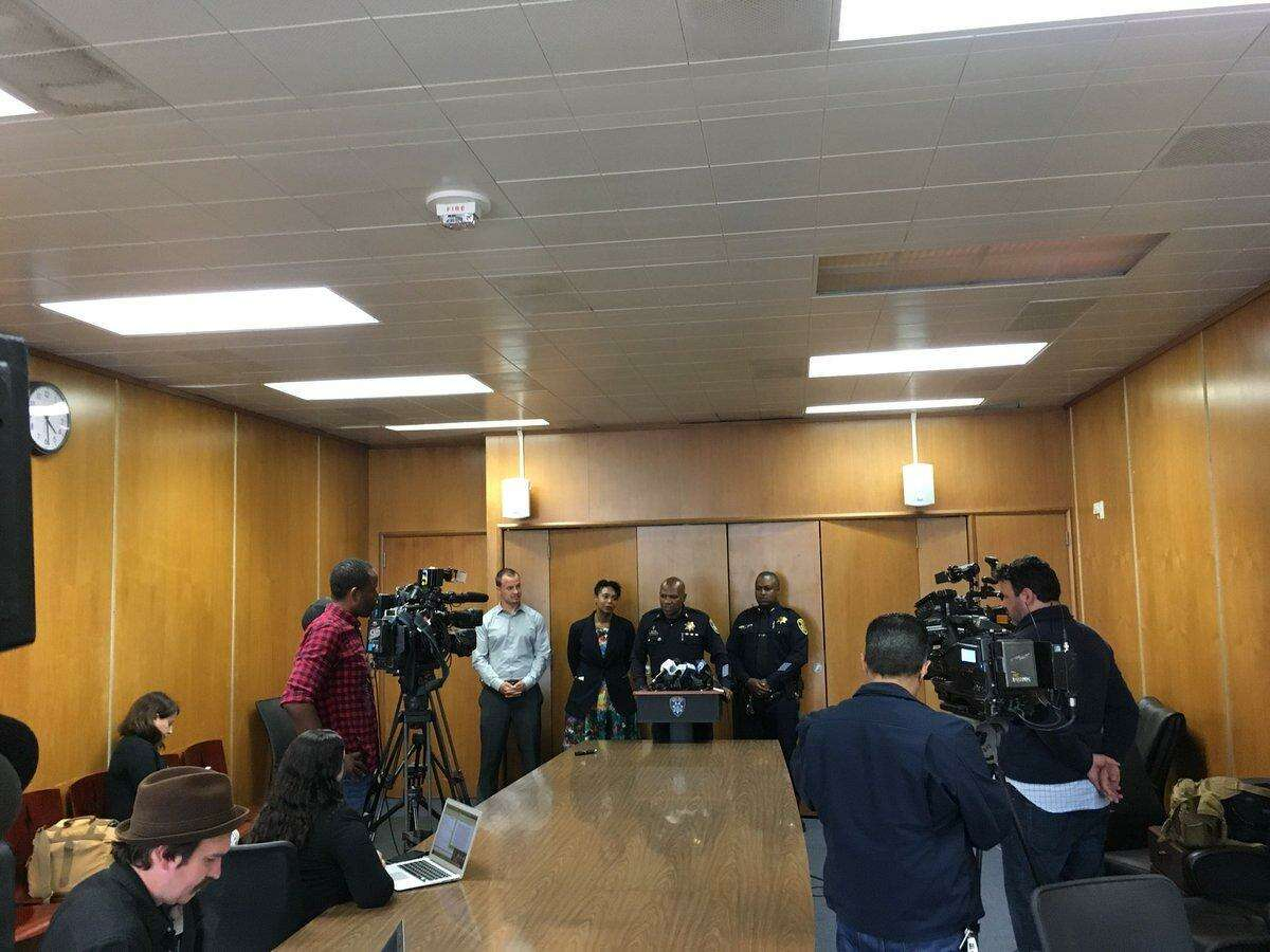 Officials with the Oakland Police Department announce a report detailing a reduction in gun homicides and nonfatal gun attacks over the past seven years in a news conference.