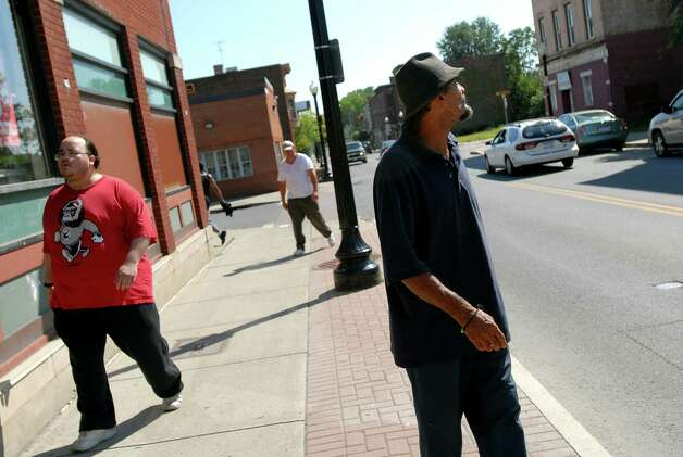 "Samuel ""Poppy"" Baez, right, strolls down Pearl Street on Tuesday, Aug. 11, 2009, in his neighborhood in Albany, N.Y. (Cindy Schultz / Times Union) Photo: CINDY SCHULTZ"