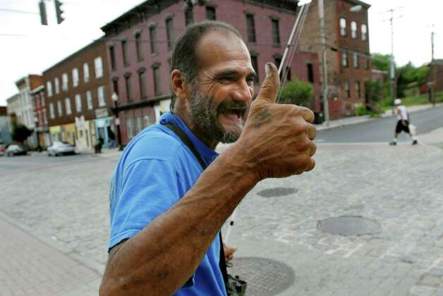 "Samuel ""Poppy"" Baez acknowledges a familiar face in his neighborhood on July 24, 2009, in Albany, N.Y. (Cindy Schultz / Times Union) Photo: CINDY SCHULTZ"