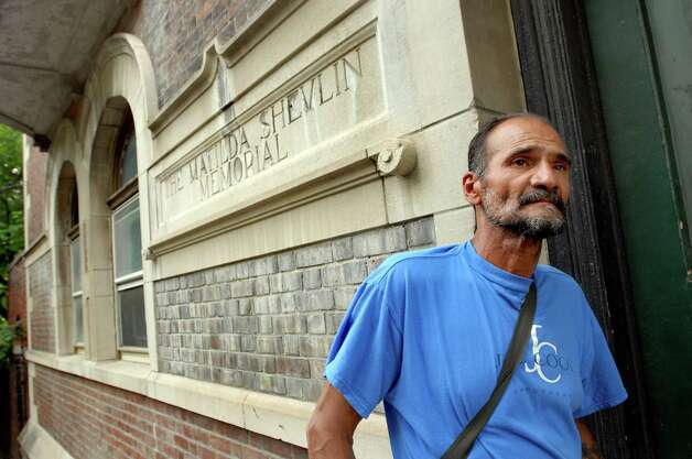 "Samuel ""Poppy"" Baez stops by a building where he once lived as he walks through the neighborhood on July 24, 2009, in Albany, N.Y. (Cindy Schultz / Times Union) Photo: CINDY SCHULTZ"