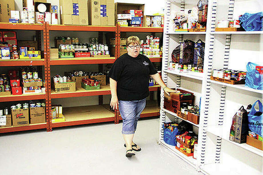 Julie Goheen, a caseworker for The Salvation Army of Jersey County, shows off the food pantry at the new social service center at 813 W. Carpenter St. The new facility has about 3,000 square feet of space, compared to 750 at the old building. Photo:       Scott Cousins | Hearst Illinois