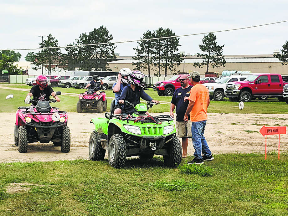 Riders discuss their next move at the weekend festival. (Tereasa Nims/For the Daily News) Photo: Tereasa Nims/for The Daily News