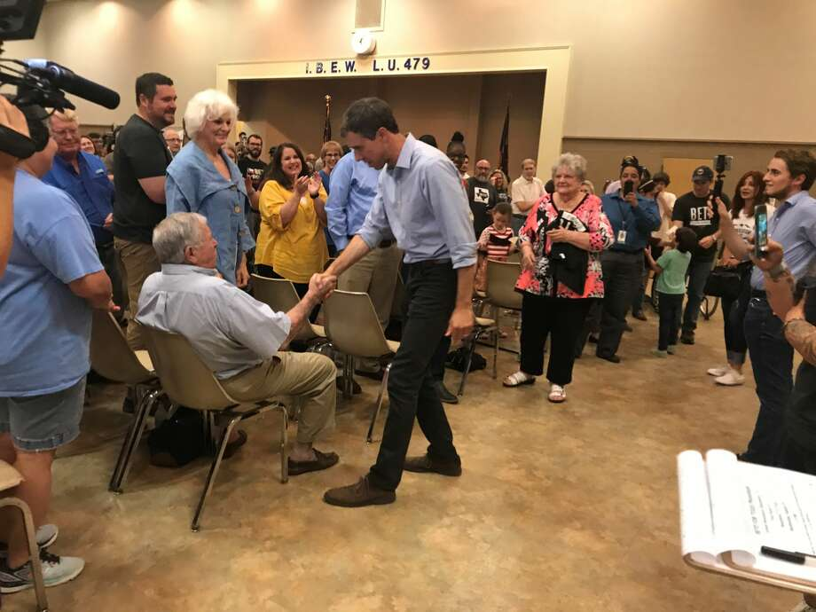 U.S. Senate candidate Beto O'Rourke shakes hands as he enters the IBEW hall on Spindletop Road in Beaumont for a town hall meeting Tuesday evening. Photo: Haley Bruyn/The Enterprise