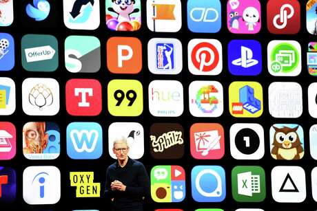 Apple CEO Tim Cook speaks before a display of apps during the Apple Worldwide Developers Conference in San Jose, California, on June 4, 2018.