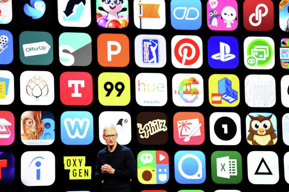Apple CEO Tim Cook speaks before a display of apps during the Apple Worldwide Developers Conference in San Jose, California, on June 4, 2018. Cook takes to the stage on March 25, 2019, to launch a new video service, entering the same arena as streaming giants Netflix, Hulu and Amazon Prime.  NEXT: See what's coming this month on streaming services.  Photo: David Paul Morris/Bloomberg / Bloomberg